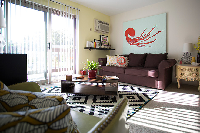 My one-bedroom apartment is full of original art and thrift finds. Nearly everything was purchased secondhand.  (Photo: Mike Gruszynski, G6 Studios)